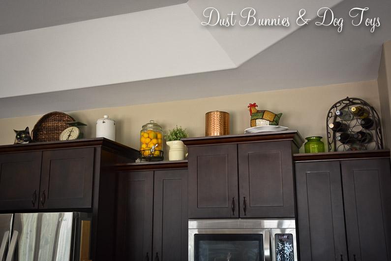 Kitchen cabinet top decor for Best kitchen decor