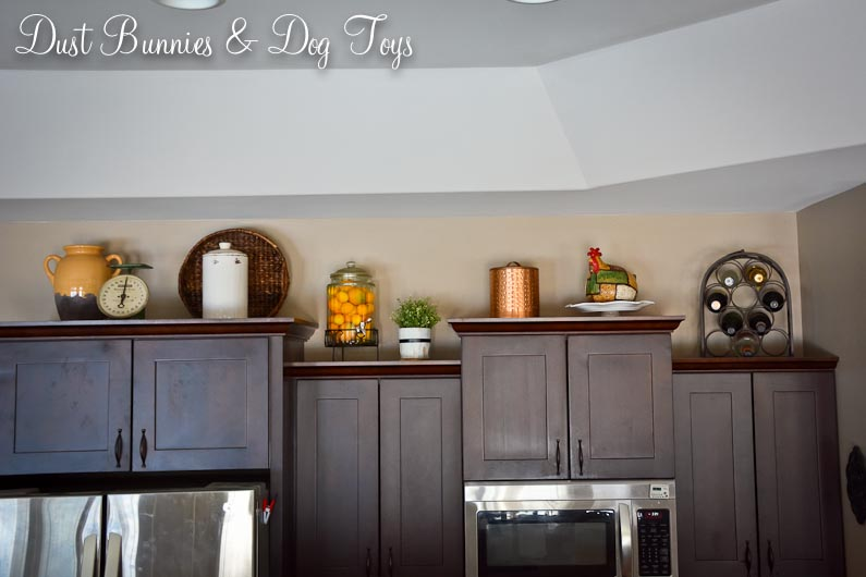 kitchen cabinet top decor dust bunnies and dog toys